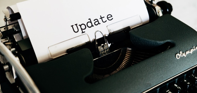 Typewriter with text 'Update' on paper